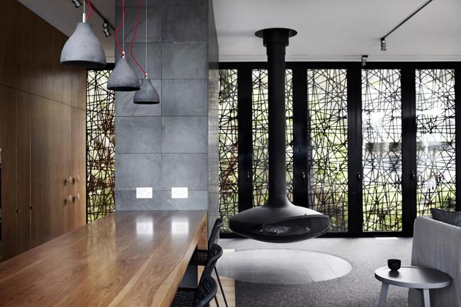Maison contemporaine bois et beton cheminee suspendue