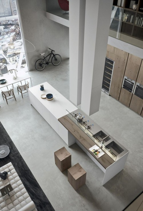 Cuisine moderne avec grand ilot central dans un loft for Decoration loft